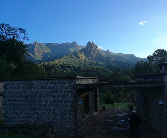 Bale Mountains Lodge entrance and mountain under blue sky