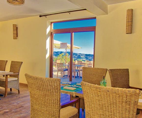 Inside dining area looking out at view of mountains at Gondar Hills Resort