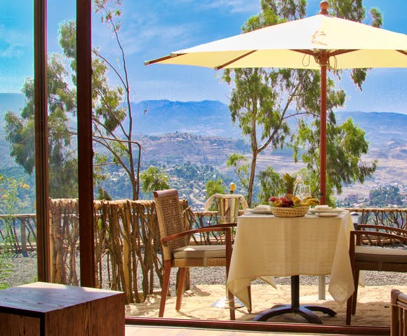 Dining table with mountains in the background at Gondar Hills Resort