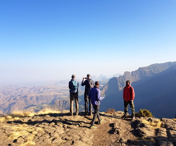 People looking at views in the Simien Mountains with blue skies